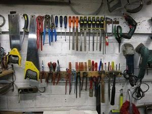 Image of tools on a garage wall