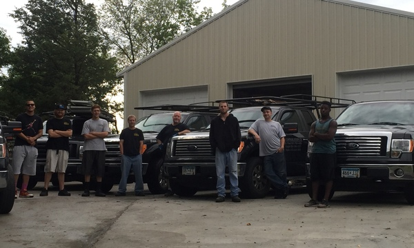 Image of the AA Garage Door team with their trucks