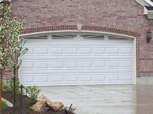Image of white arched garage door with windows at the top