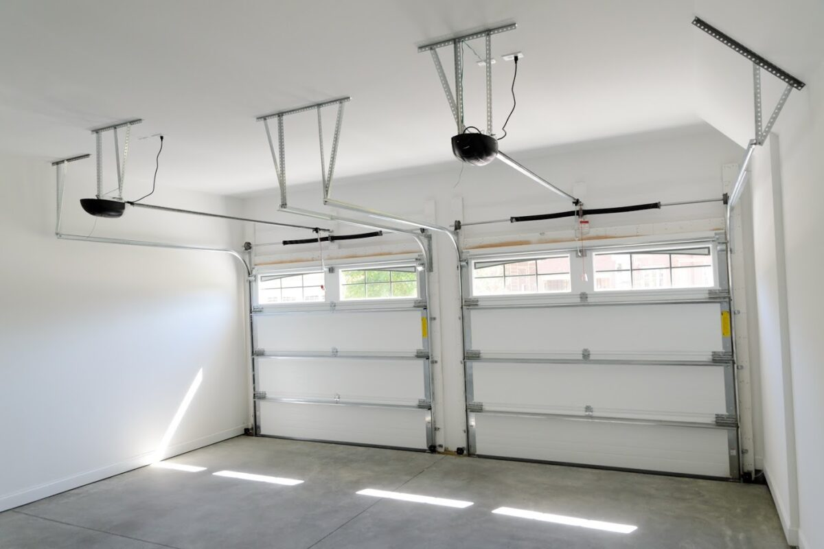 4 Differences Between Chain Drive & Belt Drive Garage Door Openers